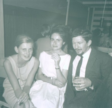 A young Gunnie sits with friends.