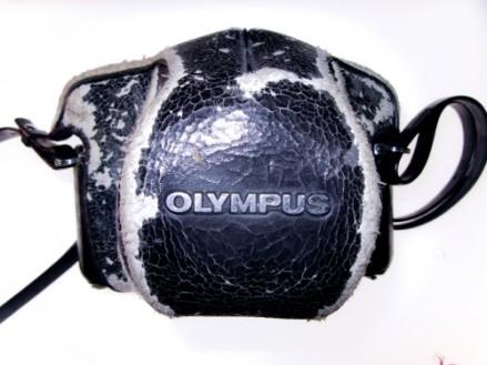 Gunnie's well worn camera case, scuffed around the edges.