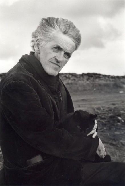 Writer George Mackay Brown windwept hair holding his cat Gypsy