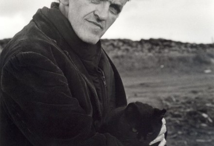 Writer George Mackay Brown windwept hair holding his cat Gypsy
