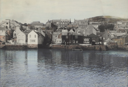 Stromness waterfront black and white photograph lightly hand tinted