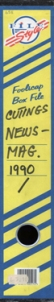 A box file label in 1980s style graphics in blue and yellow, the handwriting reads 'Cuttings News Mag 1990 -'