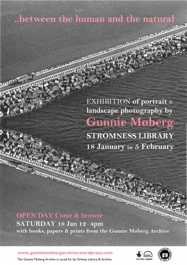 Poster for exhibition with image of causeway running diagonal across a sea, a lorry on the causeway carries bricks that look like small versions of the blocks that line the Churchill barrier. Image is reflected below making the diagonal become a chevron.