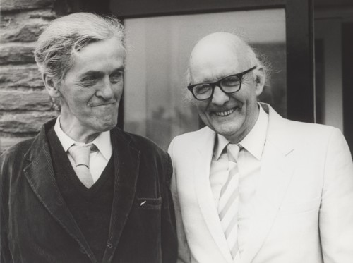 On the left the poet George Mackay Brown his hair is combed back and he grins chinnily into the joke he shares with fellow poet Ian Crichton Smith. Ian in a white suit and George in black.