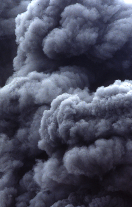 Grey smoke billows and folds into rumbling clouds.