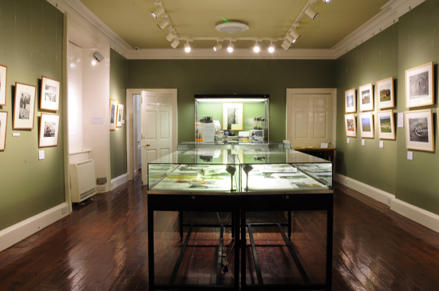 View of the gallery showing cabinets, dark wood floors
