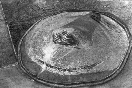 This aerial shot of Maeshowe dusted with snow and thrown into 3D by the low winter sun, looks like a limpet clinging to a beach rock.
